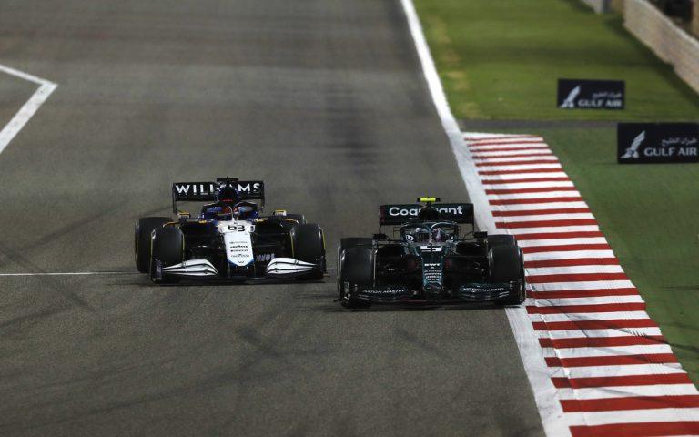 Sebastian Vettel a George Russell